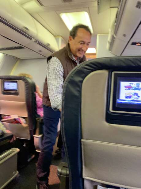 United Airlines Chief Executive Officer Oscar Munoz stops to speak with the elderly passenger he had just given his first class seat to on a Nov. 26 flight from Jacksonville, Fla. to Chicago's O'Hare International Airport.  Photo:  Rebecca Kuchar Krutz