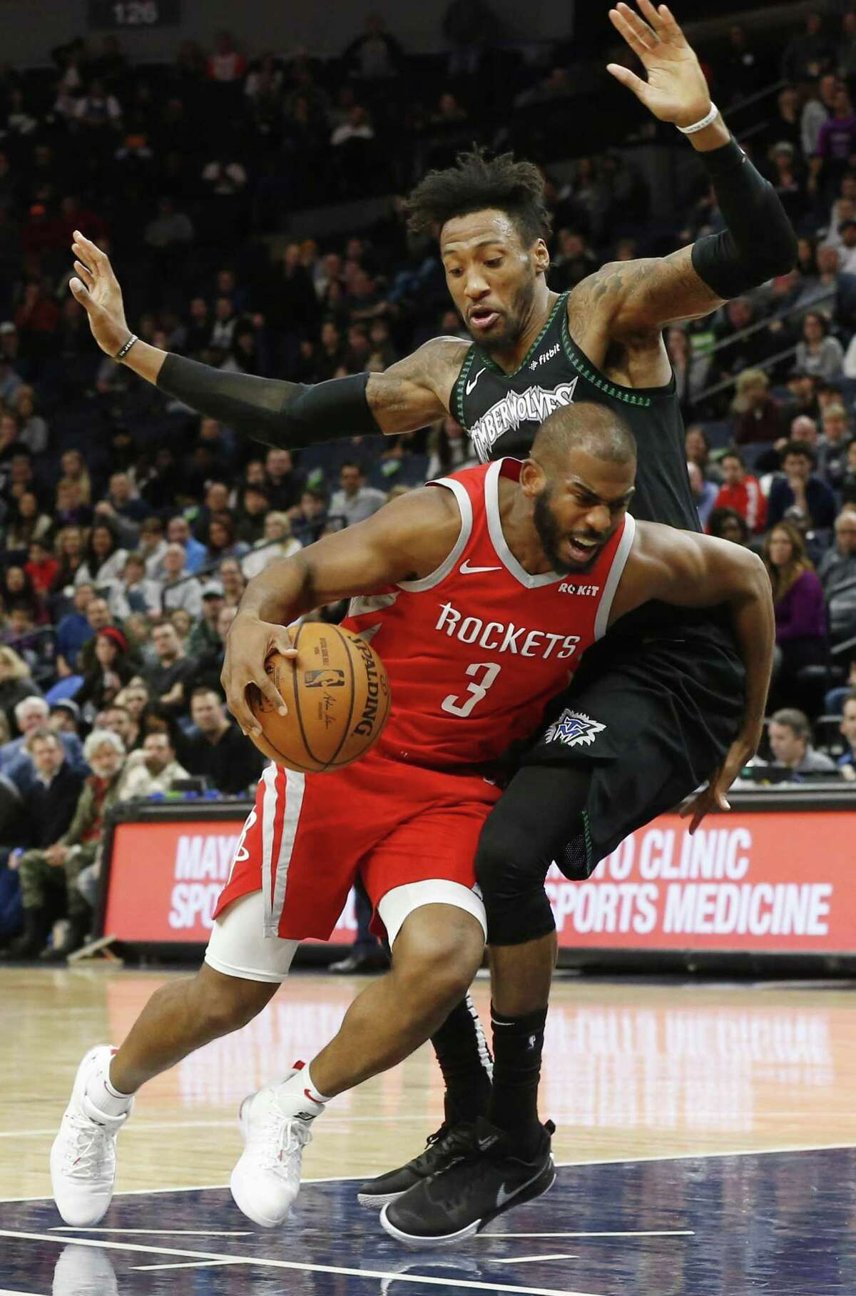 Rockets guard Chris Paul, here driving past the Timberwolves' Robert Covington on Monday, says he pushes the pace whenever possible.