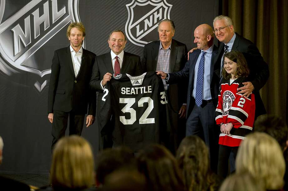 NHL commissioner Gary Bettman, center left, holds a jersey after the NHL Board of Governors announced Seattle as the league's 32nd franchise, Tuesday, Dec. 4, 2018, in Sea Island Ga.. Joining Bettman, from left to right, is Jerry Bruckheimer, David Bonderman, David Wright, Tod Leiweke and Washington Wild youth hockey player Jaina Goscinski. (AP Photo/Stephen B. Morton) Photo: Stephen B. Morton, Associated Press
