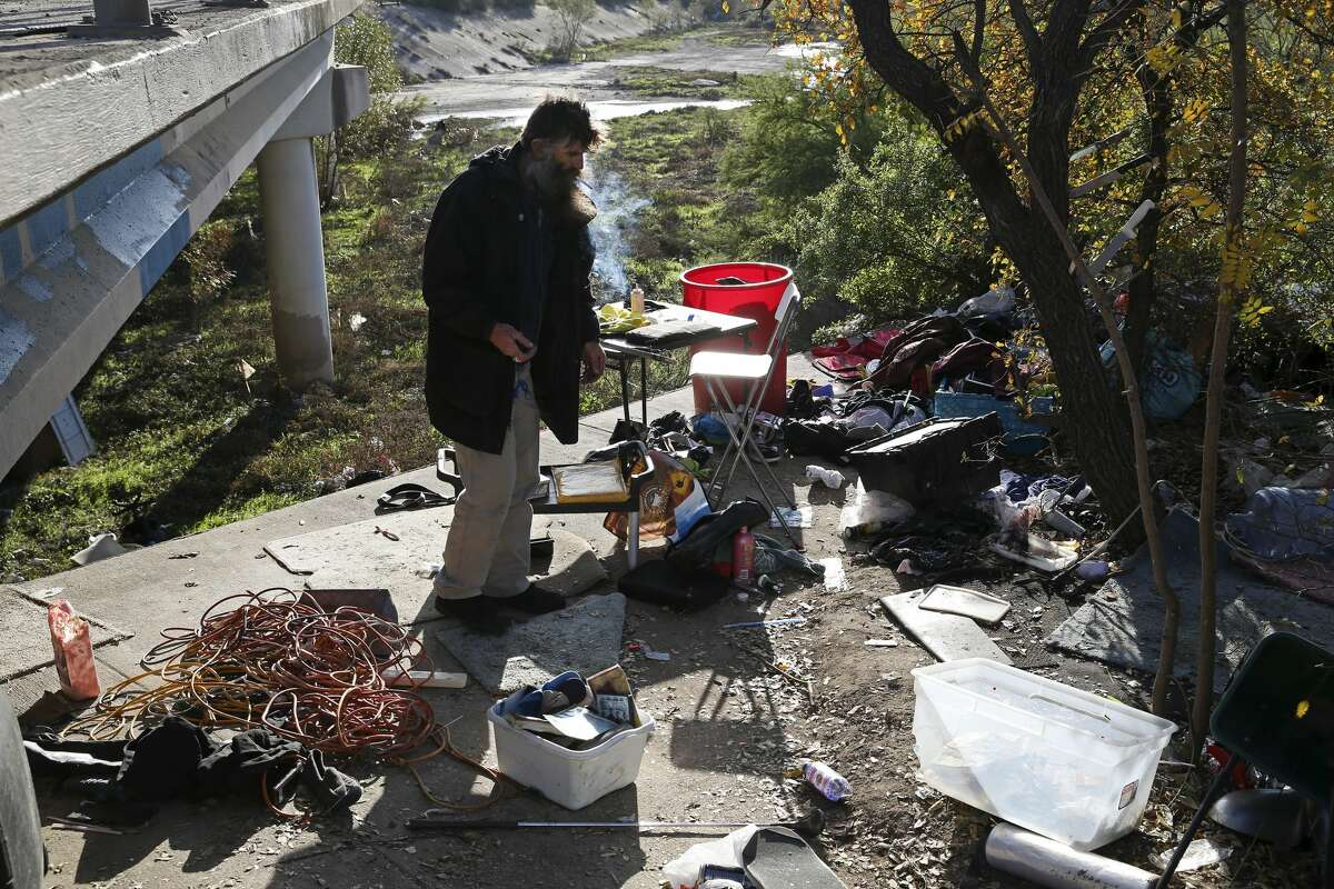 """Leland Ray Wood, 51, formerly of Lancaster, California, hangs out at his encampment by a bridge on Culebra Road, Tuesday, Dec. 4, 2018. Shortly after, personnel from the City of San Antonio Homeless Services Division, Haven for Hope and Department of Veteran Affairs visited with Wood. San Antonio City Council District 6 Representative Greg Brockhouse organized the outreach provided food and jackets to the homeless. ?'All I need is warm gloves,?"""" said Wood, who has been homeless for over 10 years."""