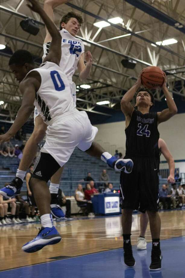 Montgomery junior Isaac Lawson (24) shoots after making a quick stop sending the New Caney defense flying past him during a District 20-5A game Tuesday, Dec. 4, 2018 in New Caney. Photo: Cody Bahn, Houston Chronicle / Staff Photographer / © 2018 Houston Chronicle