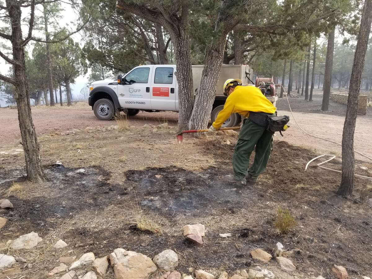 Wildfire Defense Systems firefighters perform wildfire mitigation tasks on properties threatened by the Tinder Fire earlier this year, near Happy Jack, Ariz.