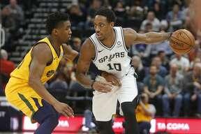 San Antonio Spurs guard DeMar DeRozan (10) drives against Utah Jazz guard Donovan Mitchell, left, in the first half of an NBA basketball game Tuesday Dec. 4, 2018, in Salt Lake City. (AP Photo/Rick Bowmer)