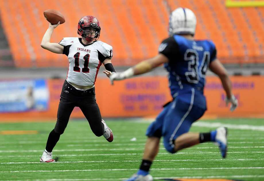 Glens Falls' Joseph Girard III looks to throw against Batavia during the 2018 Class B NYSPHSAA Football Championships in Syracuse, N.Y., Saturday, Nov. 24, 2018. Glens Falls claimed the Class B title with a 55-32 win over Batavia-V. (Adrian Kraus / Special to the Times Union) Photo: Adrian Kraus / © akoPhoto 2018