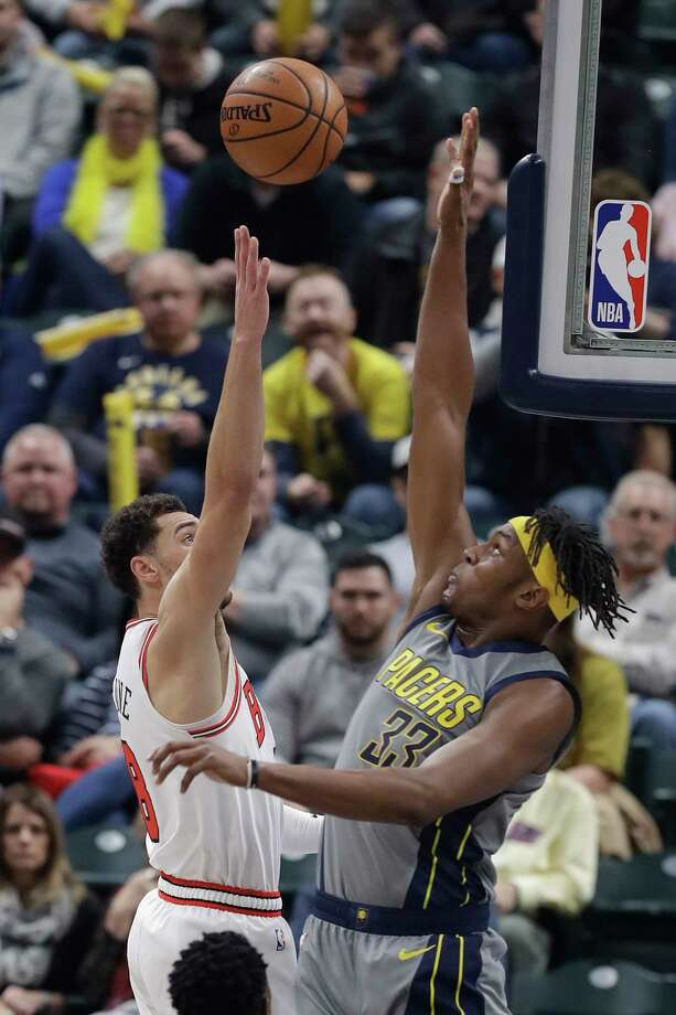 Indiana Pacers' Myles Turner (33) blocks the shot of Chicago Bulls' Zach LaVine during the first half of an NBA basketball game, Tuesday, Dec. 4, 2018, in Indianapolis. (AP Photo/Darron Cummings) Photo: Darron Cummings / Copyright 2018 The Associated Press. All rights reserved