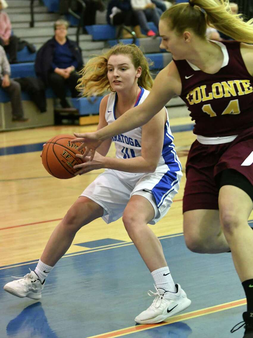 Saratoga's Kerry Flaherty drives to the basket guarded by Colonie's Makayla Blake during a basketball game on Tuesday, Dec. 4, 2018 in Saratoga Springs, N.Y. Flaherty got her 1,000th career point during the first quarter. (Lori Van Buren/Times Union)