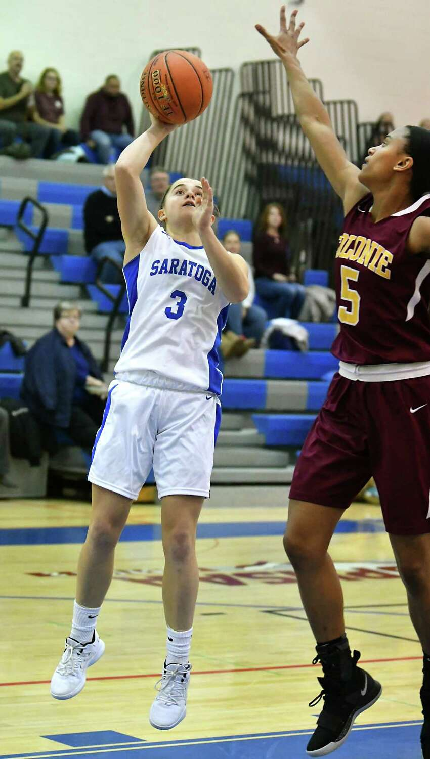 Saratoga's Catherine Cairns makes a layup guarded by Colonie's Kyara Triblet after an assist by Kerry Flaherty during a basketball game on Tuesday, Dec. 4, 2018 in Saratoga Springs, N.Y. (Lori Van Buren/Times Union)