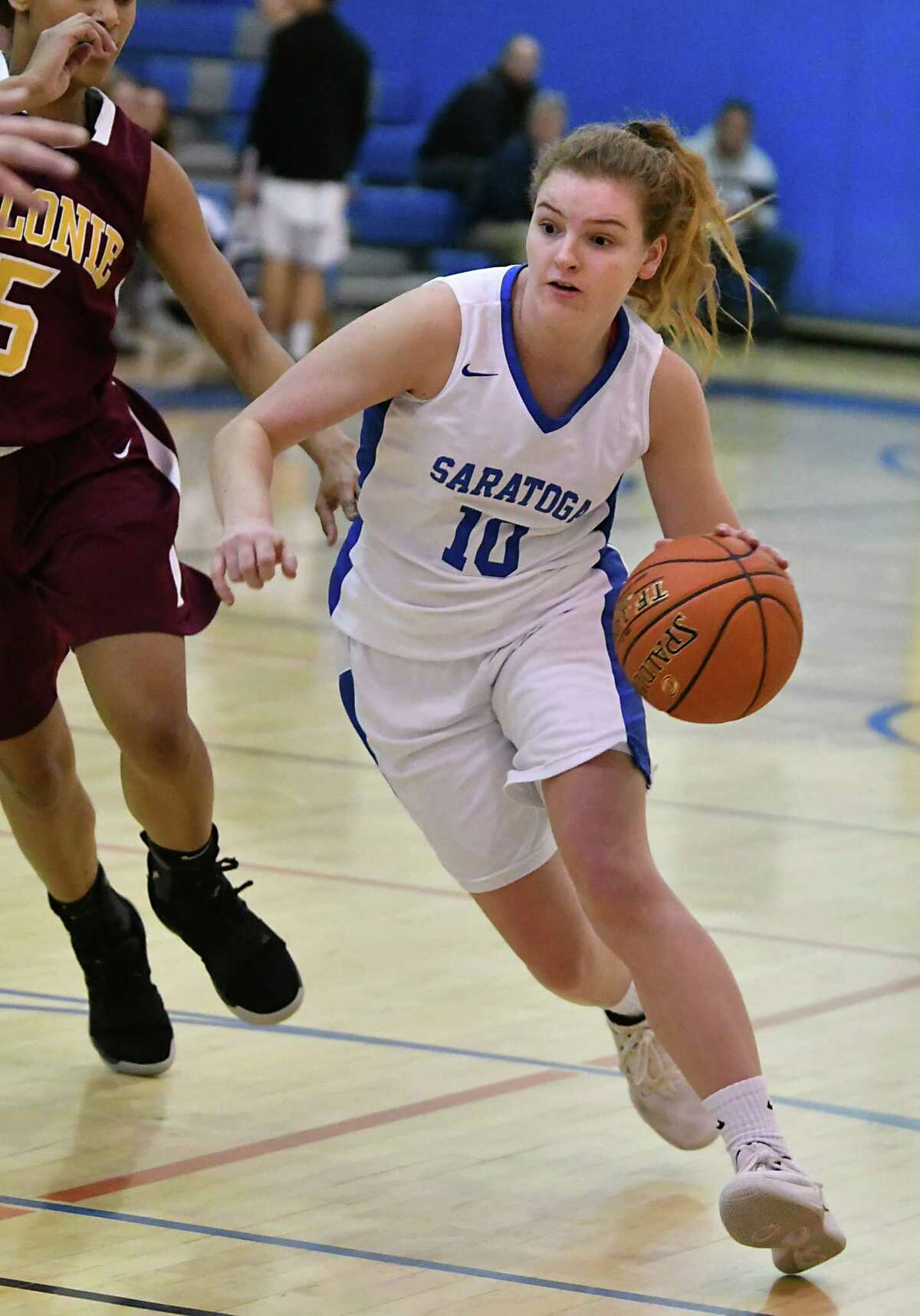 Saratoga's Kerry Flaherty drives to the basket during a basketball game against Colonie on Tuesday, Dec. 4, 2018 in Saratoga Springs, N.Y. Flaherty got her 1,000th career point during the first quarter. (Lori Van Buren/Times Union)