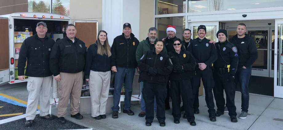 The New Milford Police Department conducted a toy drive Saturday in conjunction with the Northville Fire Department and New Milford Social Services, as well as other community partners, including Kohls and Big Lots. Police said the event was successful and called the community support overwhelming. Photo: Contributed Photo