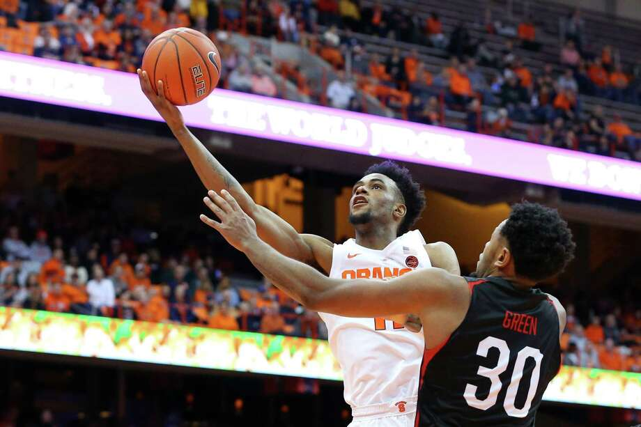 SYRACUSE, NY - DECEMBER 04:  Oshae Brissett #11 of the Syracuse Orange shoots the ball against the defense of Anthony Green #30 of the Northeastern Huskies during the second half at the Carrier Dome on December 4, 2018 in Syracuse, New York. Syracuse defeated Northeastern 72-49. (Photo by Rich Barnes/Getty Images) Photo: Rich Barnes / 2018 Getty Images