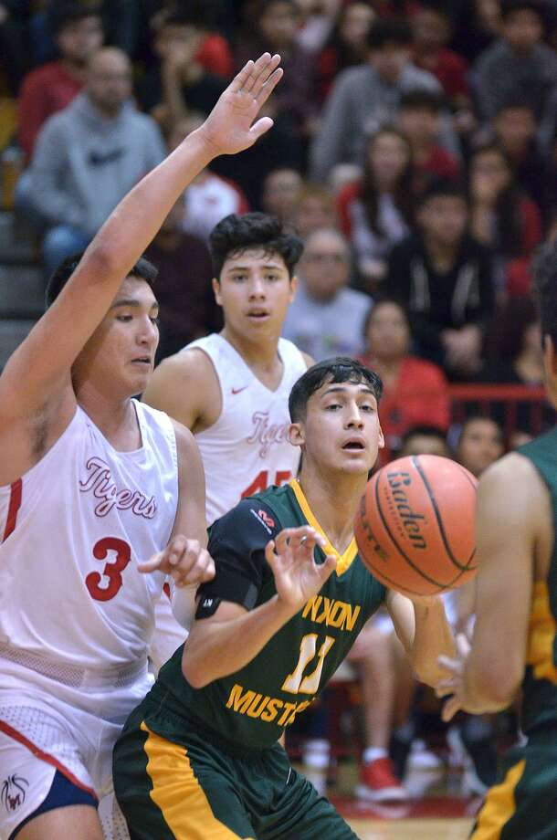 Joel Pena and Nixon fell to Deer Park 73-63 in the Pride of Texas Tournament title match Saturday. Pena was named to the all-tournament team. Photo: Cuate Santos /Laredo Morning Times File / Laredo Morning Times