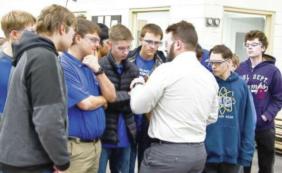 Tom Stoney, director of manufacturing at Case Systems, explains the details of manufacturing to Midland High School robotics team students during their recent visit. (Submitted photo)