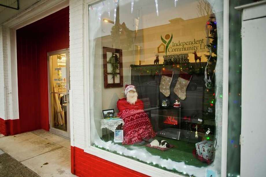 A window display arranged by Independent Community Living is one of four displays at Ace Hardware on Main Street that are competing for cash prizes. (Katy Kildee/kkildee@mdn.net)