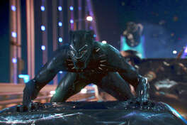 """This image released by Disney shows a scene from Marvel Studios' """"Black Panther."""" As Hollywood?'s awards season properly gets under way, ?""""Black Panther?"""" is poised to be the first comic book film to be nominated for best picture. (Matt Kennedy/Marvel Studios-Disney via AP)"""