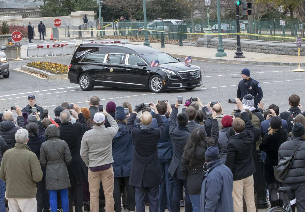 The hearse bearing the casket of former President George H.W. Bush leaves the Capitol on the way to a State Funeral at Washington National Cathedral, Wednesday, Dec. 5, 2018. >>Here are more photos from Wednesday's state funeral...