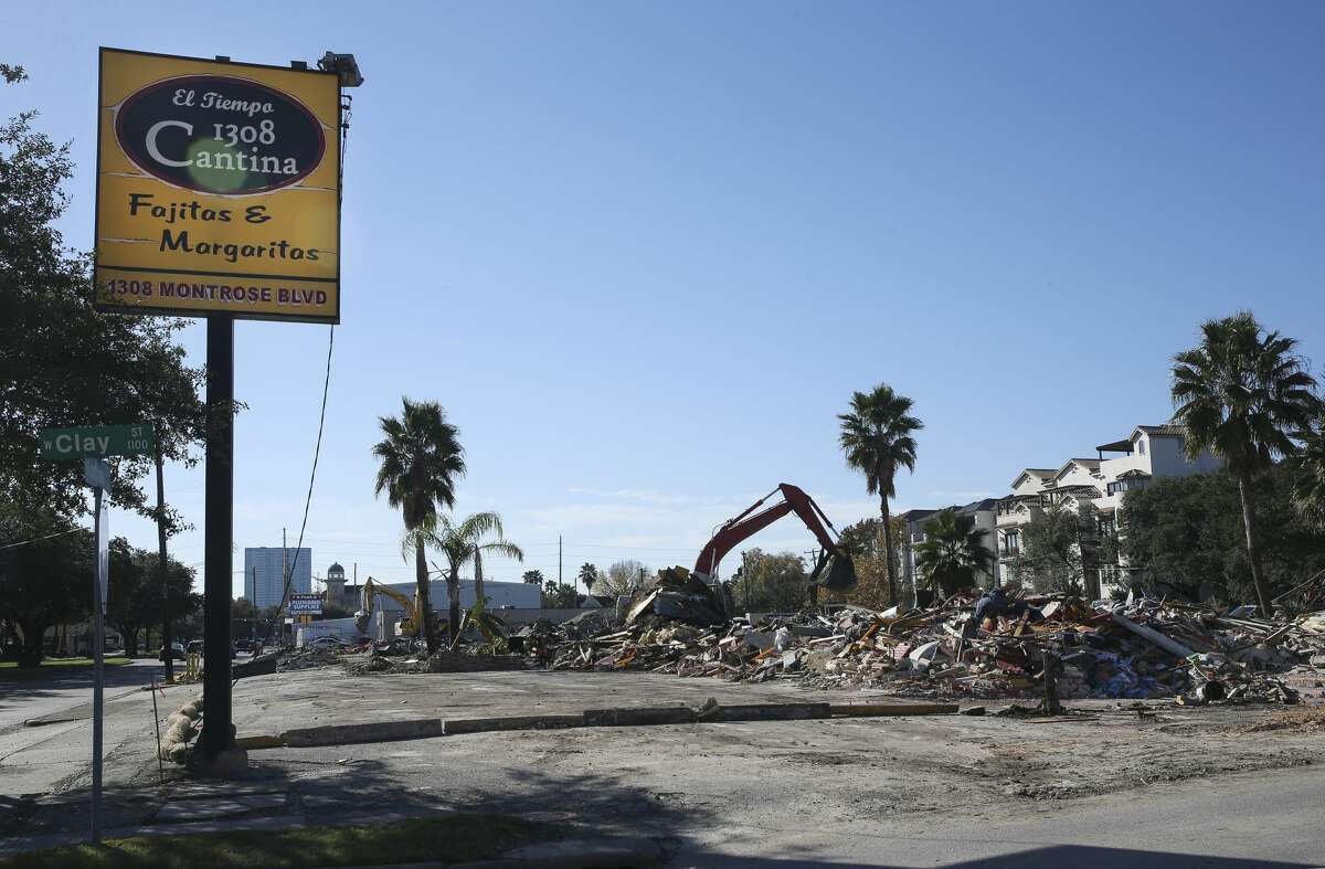 The sign is the only standing structure from El Tiempo Cantina - Montrose on 1308 Montrose Boulevard after the demolition crew destruct the buildings on Tuesday, Dec. 4, 2018, in Houston.