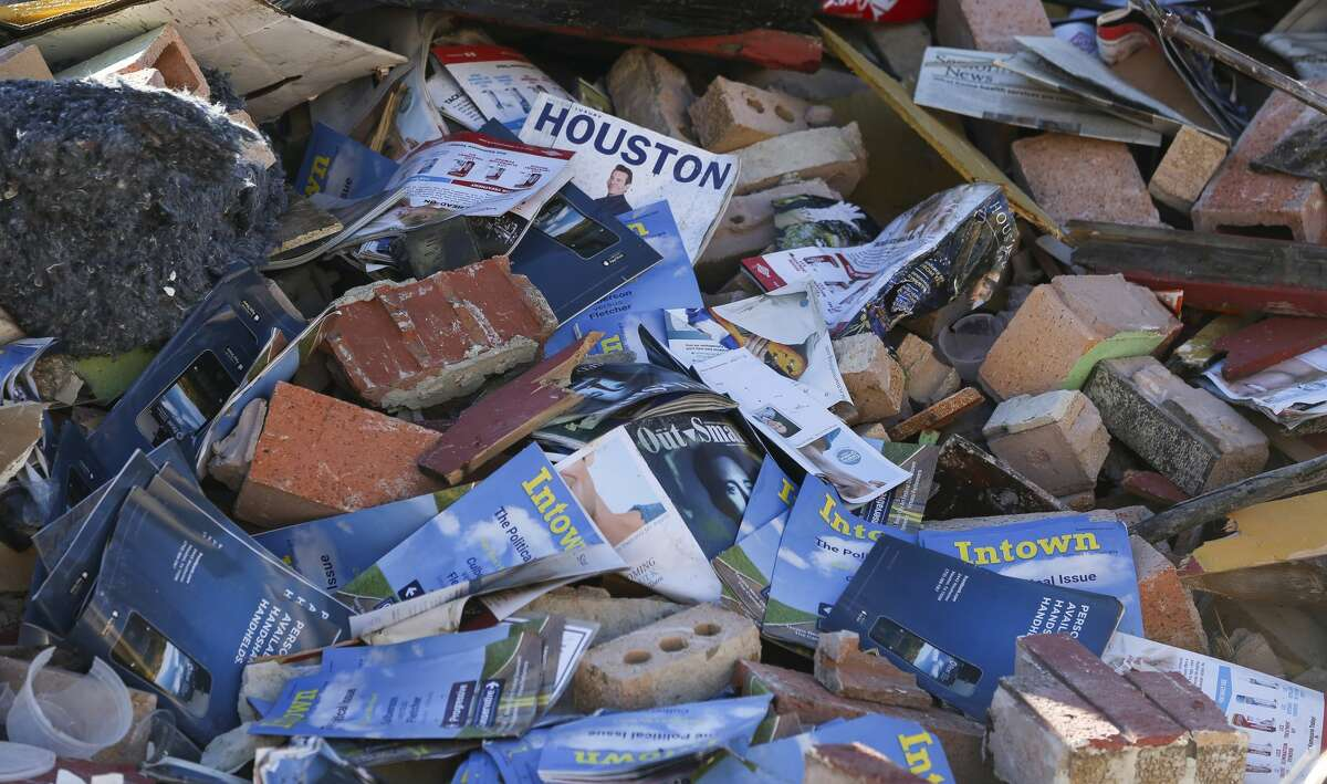 Old Houston magazines are a part of the rubble that used to be the El Tiempo Cantina - Montrose on 1308 Montrose Boulevard after the demolition crew destruct the buildings on Tuesday, Dec. 4, 2018, in Houston.