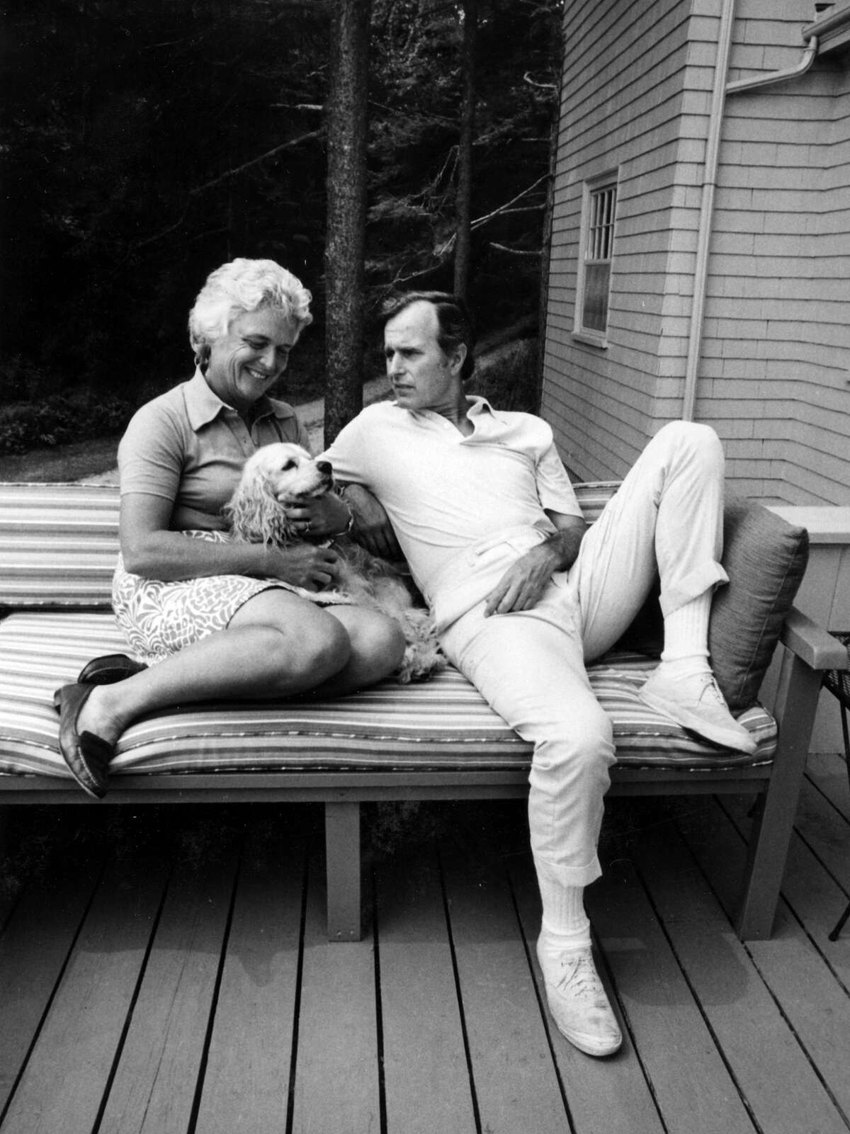 RNC Chairman George Bush relaxes with his wife, Barbara, and their Cocker Spaniel, C. Fred, at their home in Kennebunkport, ME, Summer 1974.