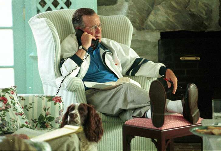 P34353-09   President Bush talks on phone, Walker's Point, Kennebunkport, ME.  His dog, Ranger, is by his side. 08 Aug 92.