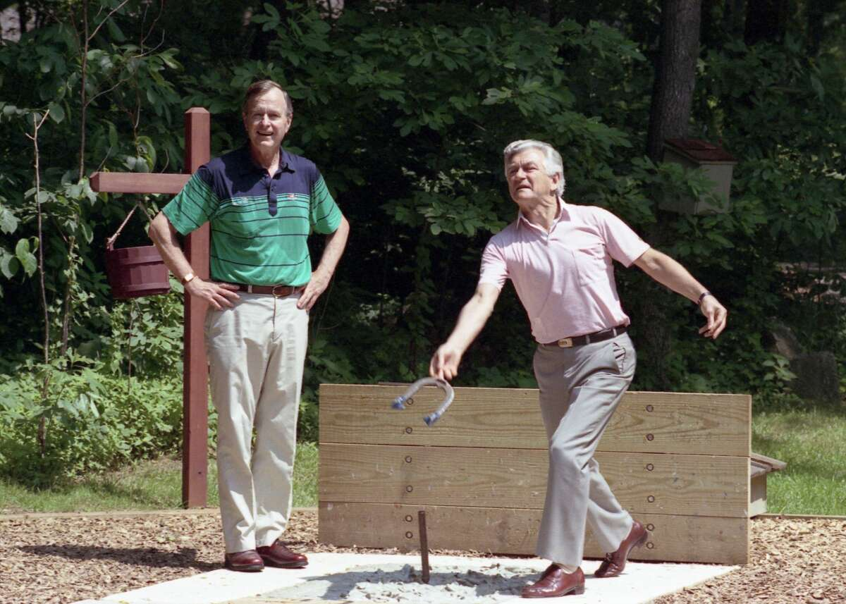 President Bush and Prime Minister Hawke of Australia pitch horseshoes at Camp David. 25 June 1989.