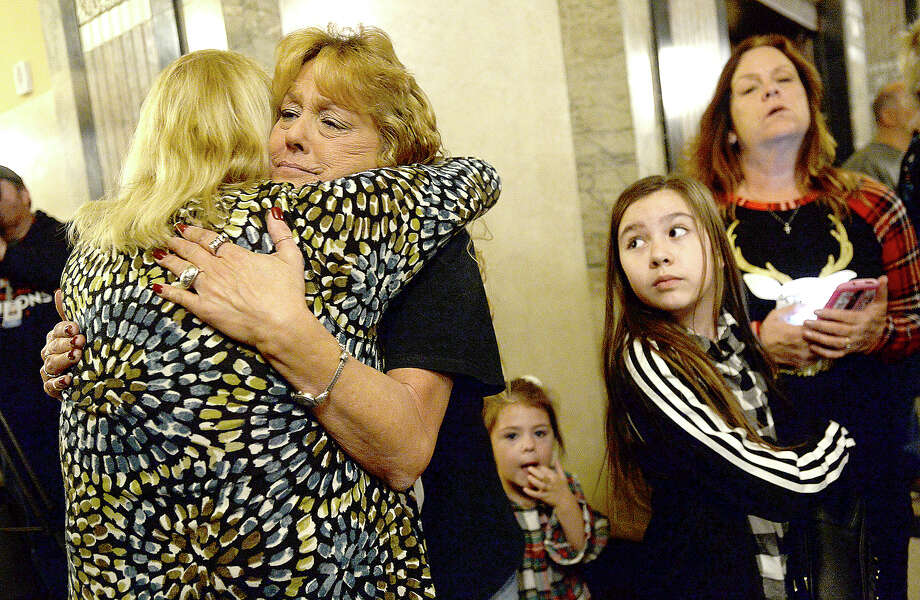 Cyndi Hebert (left) gives a hug to Stacy Bourque, whose daughter Summer Bourque was killed in 2008, as Bryleigh Dominguez, Summer's niece, looks on during the 18th annual Tree of Angels hosted by the Jefferson County Crime Victims Coalition Tuesday night in the annex at the Jefferson County Courthouse. The event offers support for families as they honor loved ones lost to violent crime and cope with their loss during the holiday season. Photo taken Tuesday, December 4, 2018 Kim Brent/The Enterprise Photo: Kim Brent/The Enterprise