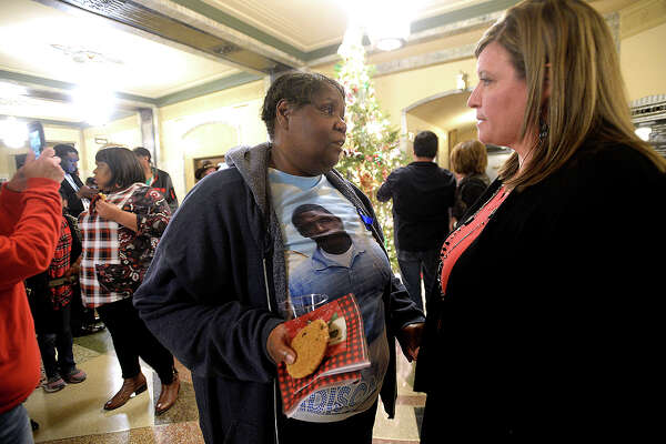 Genevia Savoy talks with Misty Craver, who offers her support for the loss of Savoy's son Bradison Mims this past October, during the 18th annual Tree of Angels hosted by the Jefferson County Crime Victims Coalition Tuesday night in the annex at the Jefferson County Courthouse. The event offers support for families as they honor loved ones lost to violent crime and cope with their loss during the holiday season. Photo taken Tuesday, December 4, 2018 Kim Brent/The Enterprise