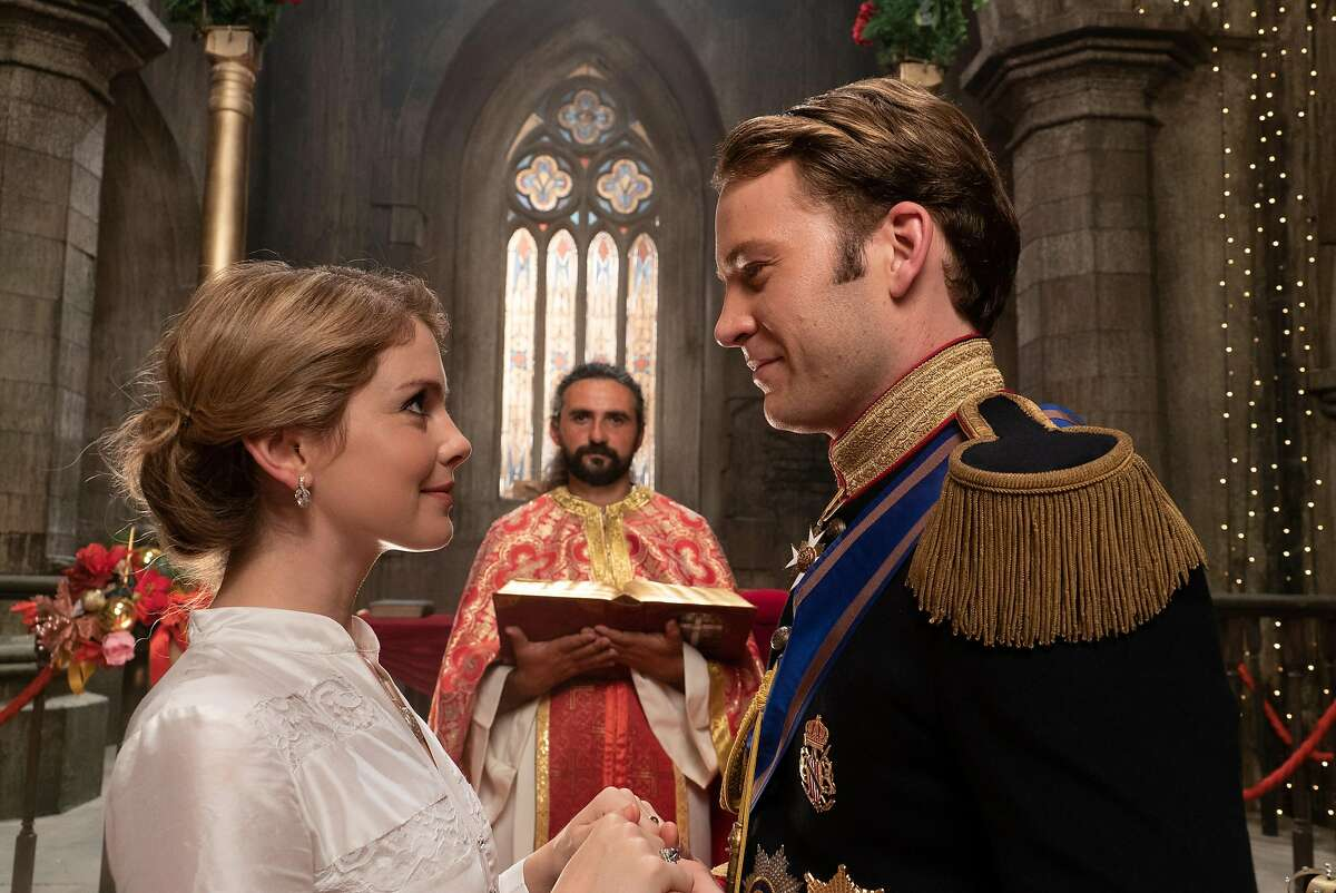 """Rose McIver and Ben Lamb in """"A Christmas Prince: A Royal Wedding."""" She goes from being a junior copy editor to getting assigned to cover the biggest royal wedding in modern history, which no one thinks is weird at all."""