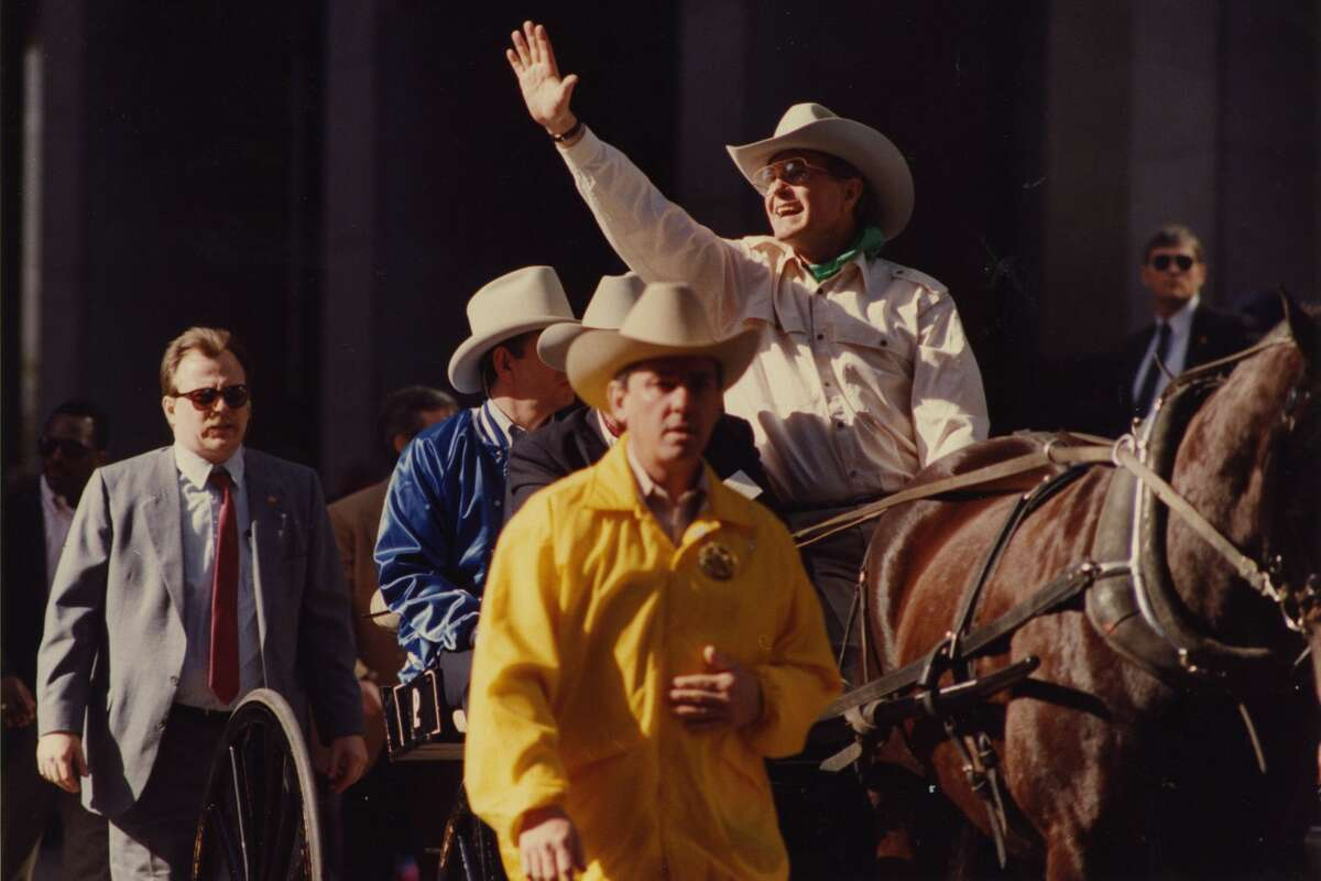 Vice President George Bush, Republican candidate for president, serves as grand marshal of the Houston Livestock Show and Rodeo parade. Bush waves to parade goers in downtown Houston, Saturday, Feb, 20, 1988.