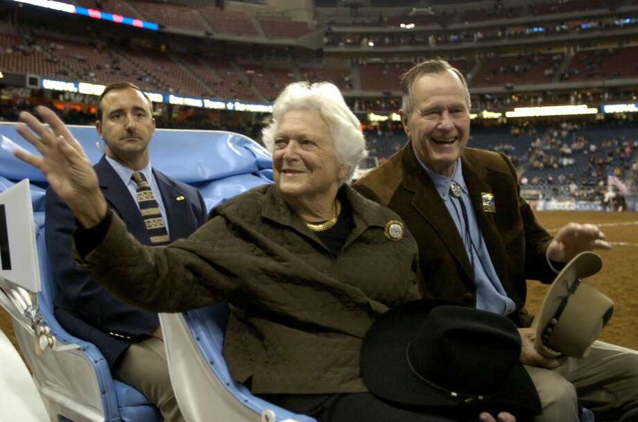 Former First Lady Barbara Bush, left, and former President George H.W. Bush ride in the grand parade during the opening performance of the Houston Livestock Show and Rodeo March 1, 2005, at Reliant Stadium in Houston. >> Keep clicking through this gallery to see Barbara and George's love story through photos. Photo: Brett Coomer/Houston Chronicle