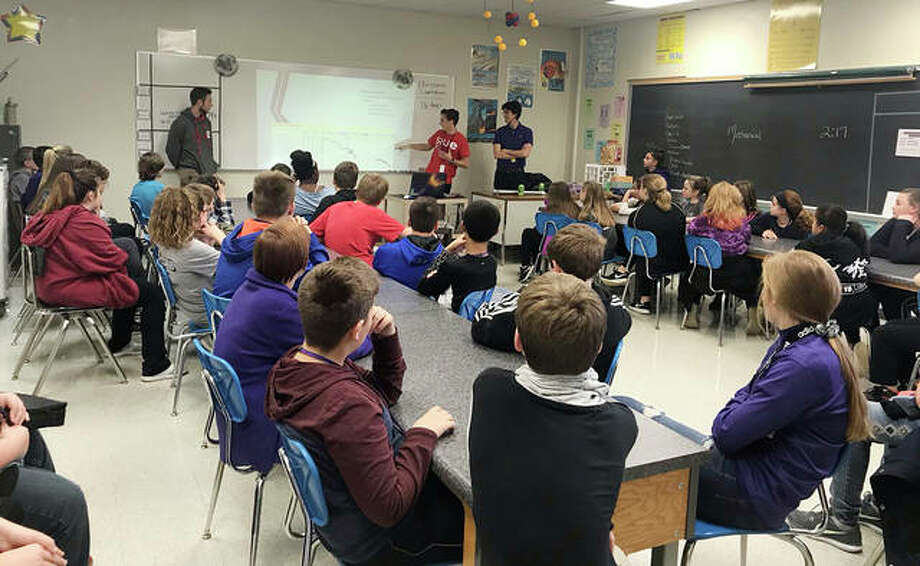 Photo (L-R): SIUE School of Engineering students Aaron Bandy, Cody Johnson, and Thomas Giacobbe visit Trimpe Middle School in Bethalto. Photo: For The Intelligencer