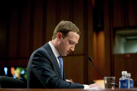 FILE- In this April 10, 2018, file photo Facebook CEO Mark Zuckerberg pauses while testifying before a joint hearing of the Commerce and Judiciary Committees on Capitol Hill in Washington about the use of Facebook data to target American voters in the 2016 election. The British Parliament has released some 250 pages worth of documents that show Facebook considered charging developers for data access. The documents show internal discussions about linking data to revenue.