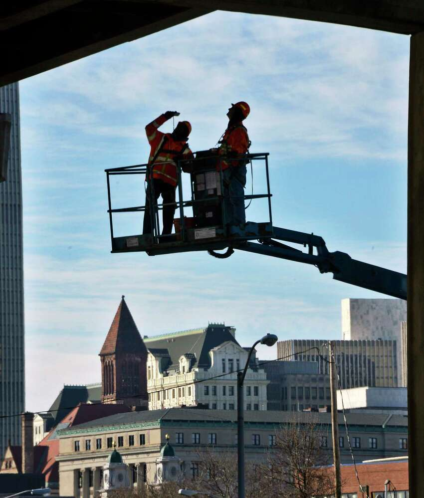 Bridge inspectors Bill Stachnik and Joe Mathias of South Col Engineering check out a support member under the I-787 southbound span on Wednesday, Dec. 5, 2018, in Albany, N.Y. (John Carl D'Annibale/Times Union)