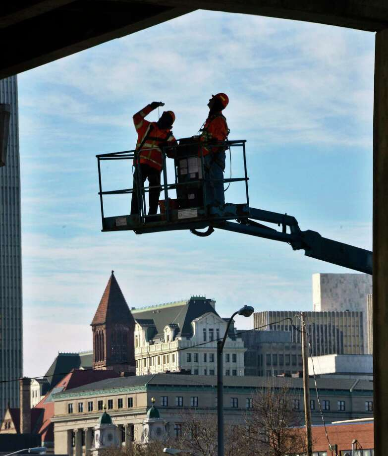 Bridge inspectors Bill Stachnik and Joe Mathias of South Col Engineering check out a support member under the I-787 southbound span on Wednesday, Dec. 5, 2018, in Albany, N.Y. (John Carl D'Annibale/Times Union) Photo: John Carl D'Annibale, Albany Times Union / 20045641A