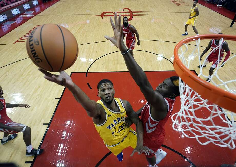 Golden State Warriors' Alfonzo McKinnie (28) goes up for a shot as Houston Rockets' Clint Capela defends during the second half of an NBA basketball game Thursday, Nov. 15, 2018, in Houston. The Rockets won 107-86. (AP Photo/David J. Phillip) Photo: David J. Phillip / Associated Press