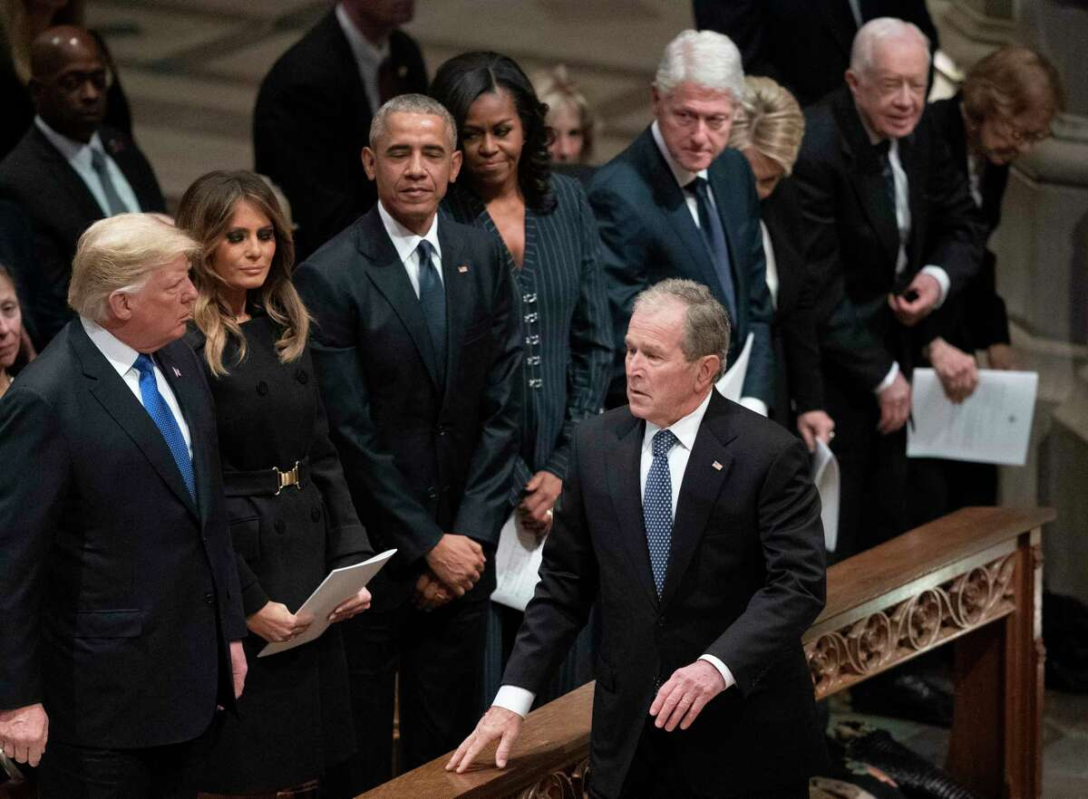 President George W. Bush walks to his seat after greeting President Donald Trump, first lady Melania Trump, former President Barack Obama, Michelle Obama, former President Bill Clinton, former Secretary of State Hillary Clinton, former President Jimmy Carter, and Rosalynn Carter during a State Funeral for former President George H.W. Bush at the National Cathedral, Wednesday, Dec. 5, 2018, in Washington.(AP Photo/Carolyn Kaster)