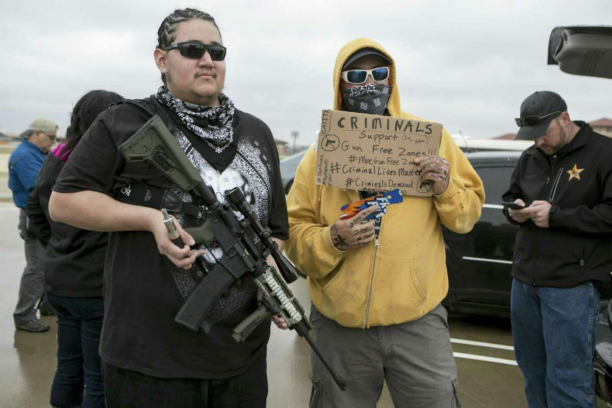 Open-carry activists demonstrated and stage a mock shooting just outside the University of Texas campus in Austin, Dec. 12, 2015.