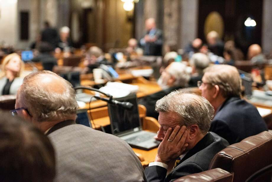 Assembly lawmakers debate bills that would strip Democratic Gov.-elect Tony Evers of his power. Photo: Lauren Justice / New York Times