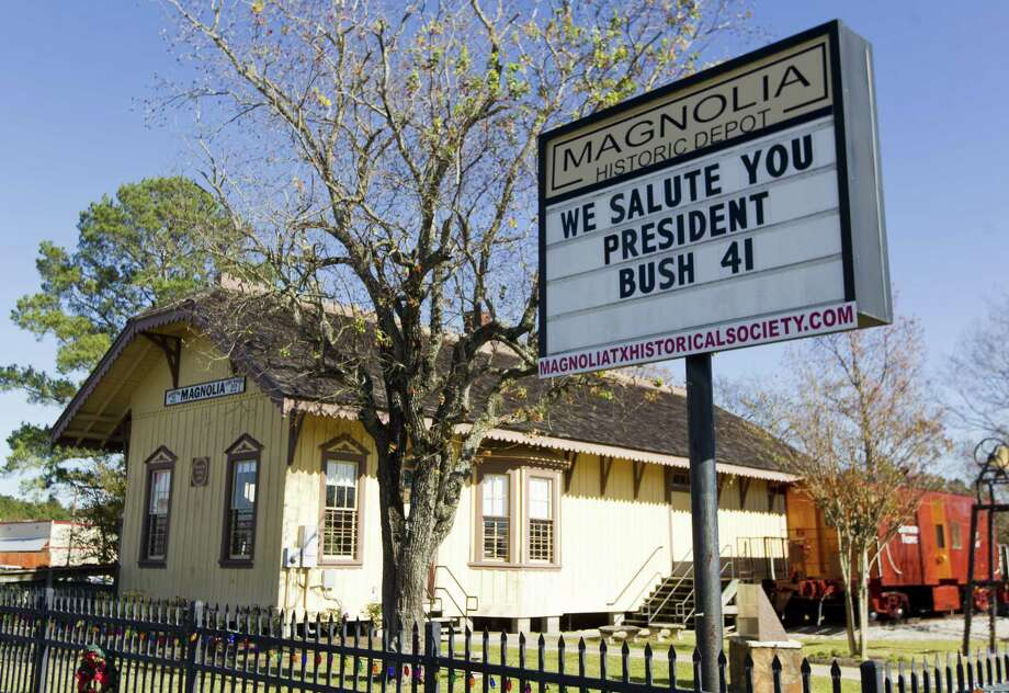 A sign outside the Magnolia Historic Train Depot shows support for President George H.W. Bush, Tuesday, Dec. 4, 2018, in Magnolia. Locomotive 4141 will pass through Magnolia on Thursday as it transports the body of President George H.W. Bush from the Union Pacific Railroad Westfield Auto Facility in Spring to the Presidential library on the campus of Texas A&M for burial. Photo: Jason Fochtman, Houston Chronicle / Staff Photographer / © 2018 Houston Chronicle