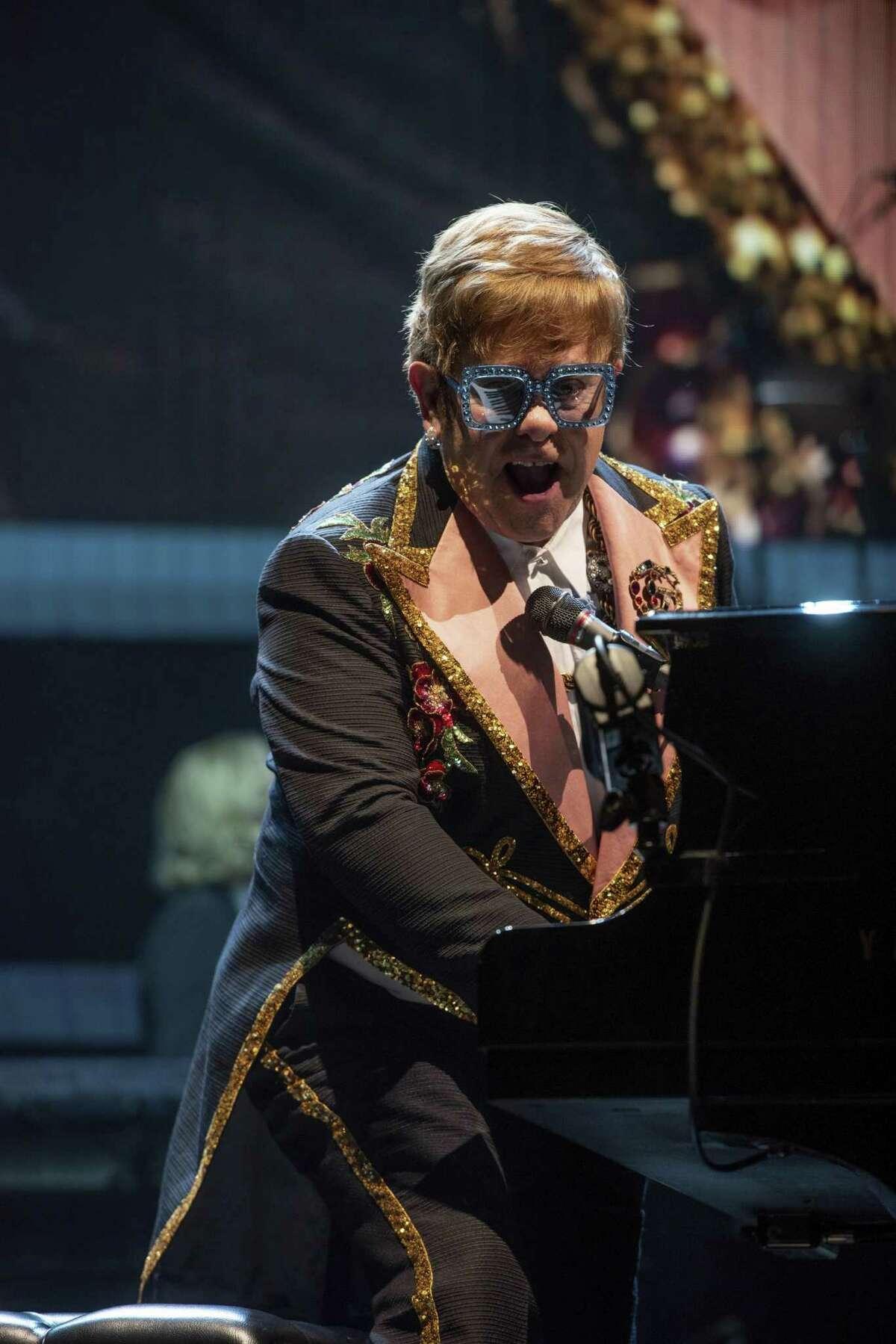 Elton John performs onstage at State Farm Arena on Saturday, Dec. 1, 2018, in Atlanta. (Photo by Paul R. Giunta/Invision/AP)