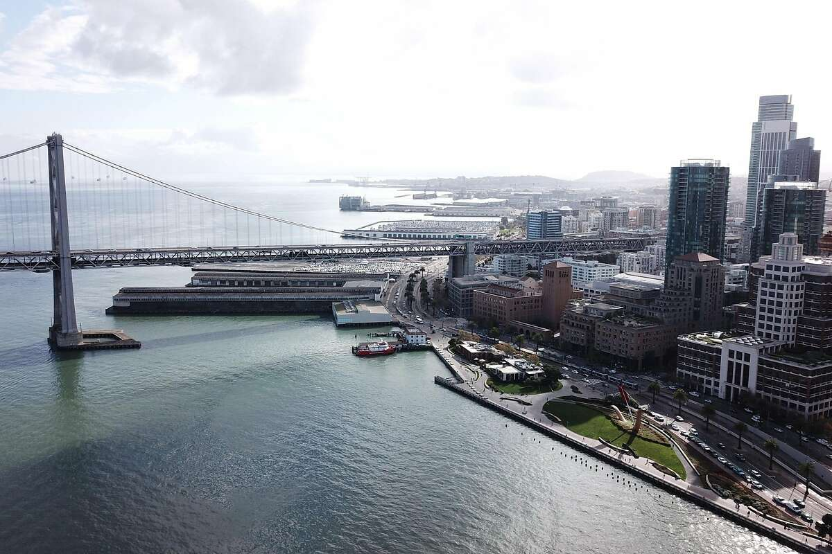 The Bay Bridge and Cupid's Span at the Embarcadero waterfront on Wednesday, Nov. 28, 2018, in San Francisco, Calif.