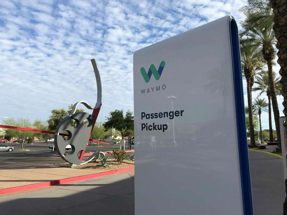 Driverless Waymo cabs are ferrying passengers around Phoenix suburbs in a first for a commercial company in the United States. Photo: Washington Post Photo By Michael Laris / TWP