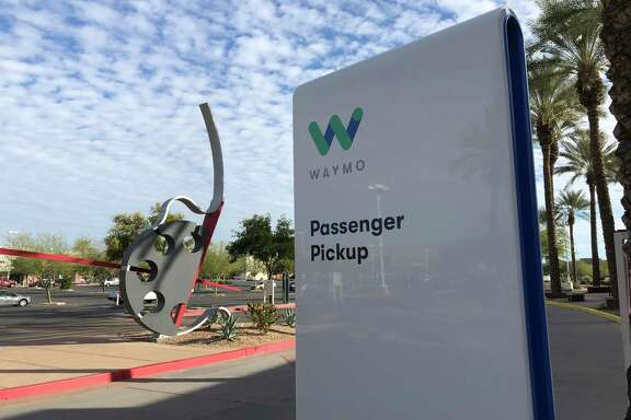 Driverless Waymo cabs are ferrying passengers around Phoenix suburbs in a first for a commercial company in the United States.
