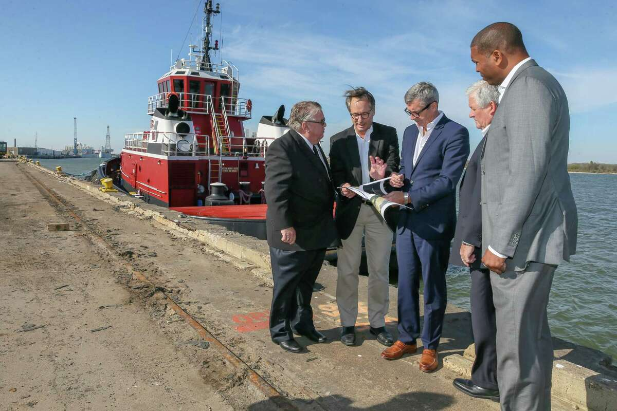 Galveston Wharves trustees and Royal Caribbean representatives look over plans for a new cruise terminal on Dec. 5, 2018, in Galveston.