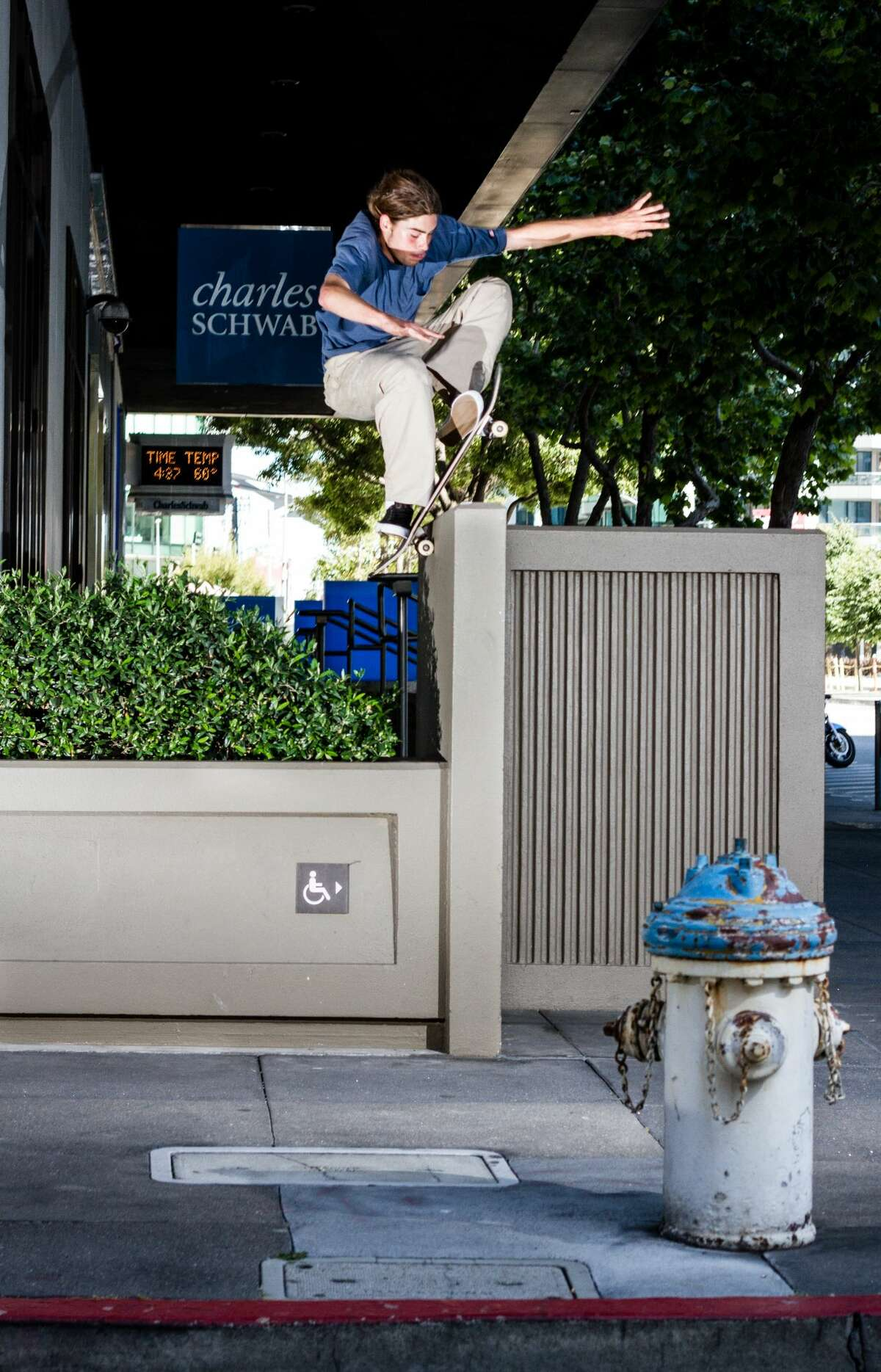 Chris Athens of Deep Fried flies up and over a wall near the Charles Schwab offices in downtown San Francisco.