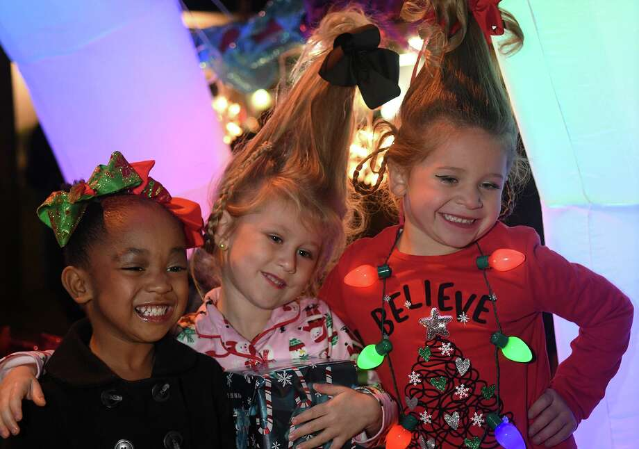 Chloe King, 4, from left, Brinley McAdams, 4, and Brilee McCrary, 4, are all smiles as they take their places on the Revolution Dance Center (of Porter) float before the start of the 27th Annual Christmas Parade of Lights down Main Street in Humble on Dec. 4, 2018. Photo: Jerry Baker, Houston Chronicle / Contributor / Houston Chronicle