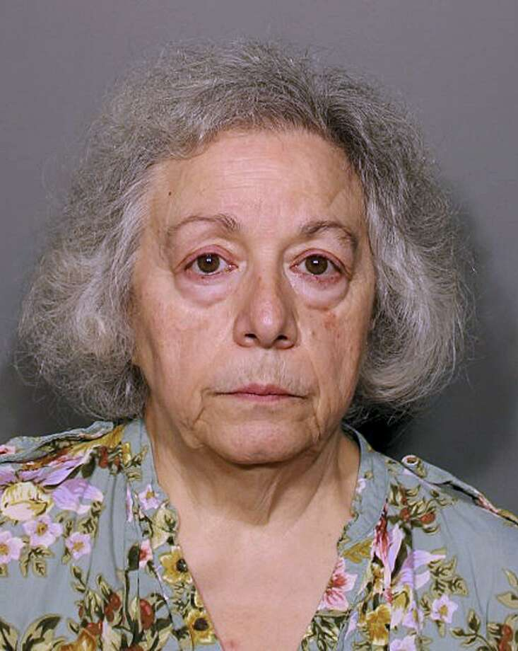 This booking photo released Monday, Aug. 13, 2018, by the New Canaan Police Department shows Marie Wilson, of Wilton, Conn., a former cafeteria worker who along with her sister Joanne Pascarelli was charged with stealing nearly a half-million dollars from New Canaan, Conn., schools over the last five years. (New Canaan Police Department via AP) Photo: /Associated Press / New Canaan Police Department