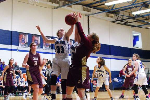 Friendswood's Lauren Lowe (33) and Christian Home School's Molly Urick (4) fight for a rebound Tuesday at Friendswood High School.