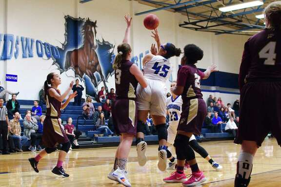 Friendswood's Ashlyn Mason (45) puts up a shot over Christian Home School's Allie Smith Tuesday at Friendswood High School.