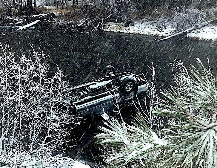 Little cold for a dip: A driver hit ice on I-80 and sailed into the Truckee River. He escaped, but not the car.