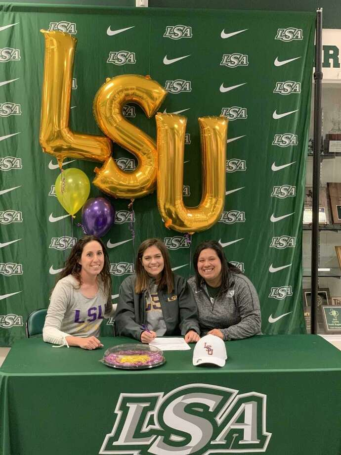 Anna Jones of Lutheran South Academy has signed a national letter of intent to play softball at LSU. Anna (center) is pictured with LSA coaches Leah Jones and Nicole Andrade. Jones is the daughter of Bill and Leah Jones. Photo: Submitted Photo